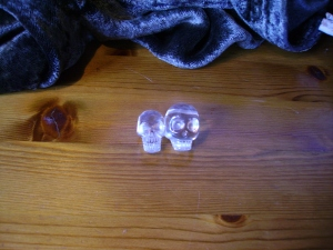 Two skulls beads of carved crystal. New Age Shop, Oxford 2000. Collected by B Basura