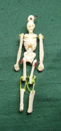 Small Dancing Skeleton. Jointed plastic skeleton marionette. height 3 inches. Mexico 1993. Collected by G. Ruddick. Donated 2015.